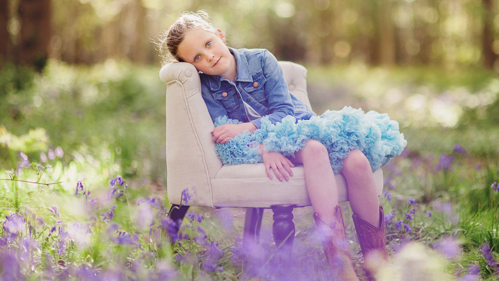 Spring time photograph of girl in bluebell wood
