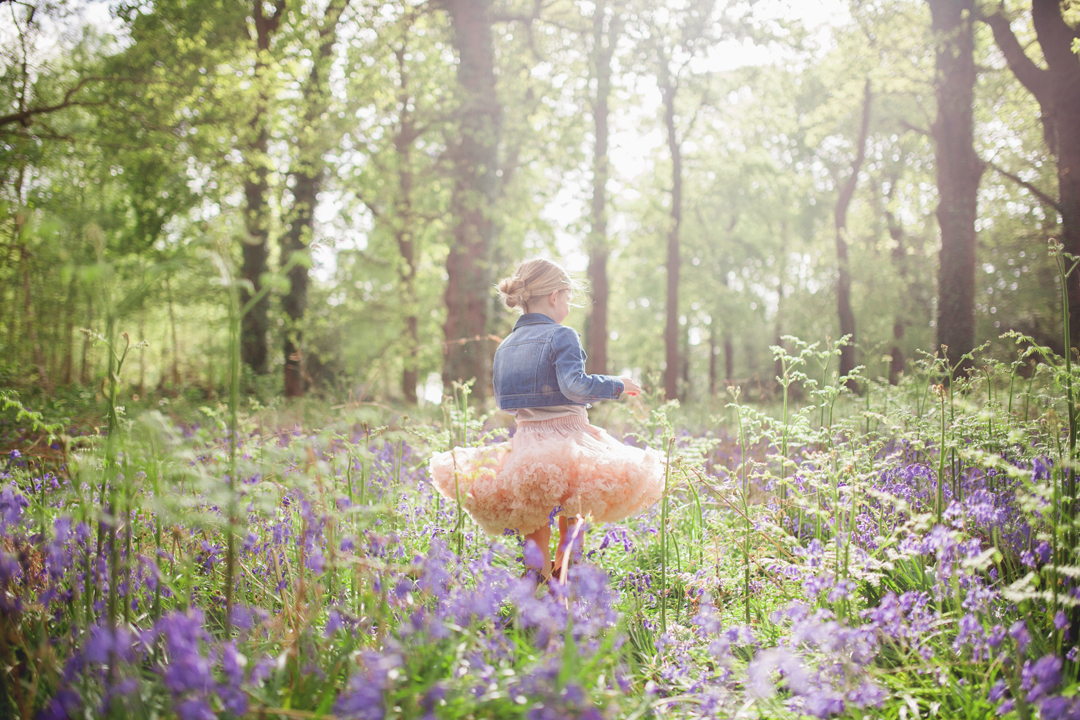 Spinning girl in the Bluebell wood