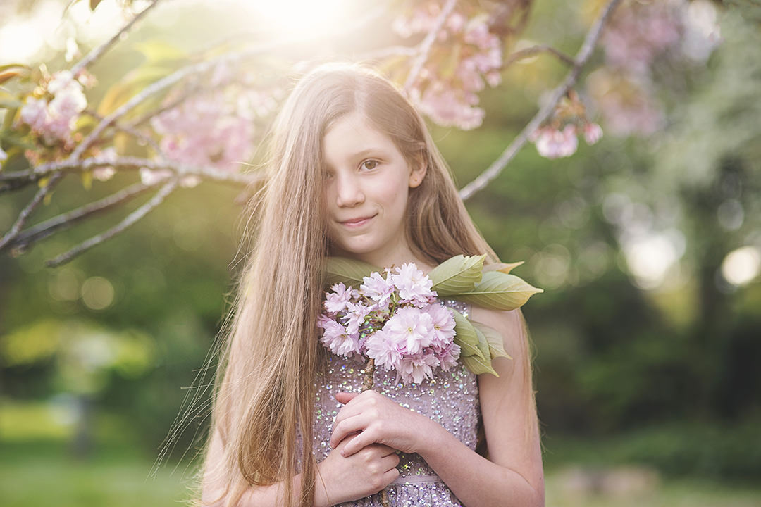 Portrait of girl in spring blossom by Moira Lizzie Photography