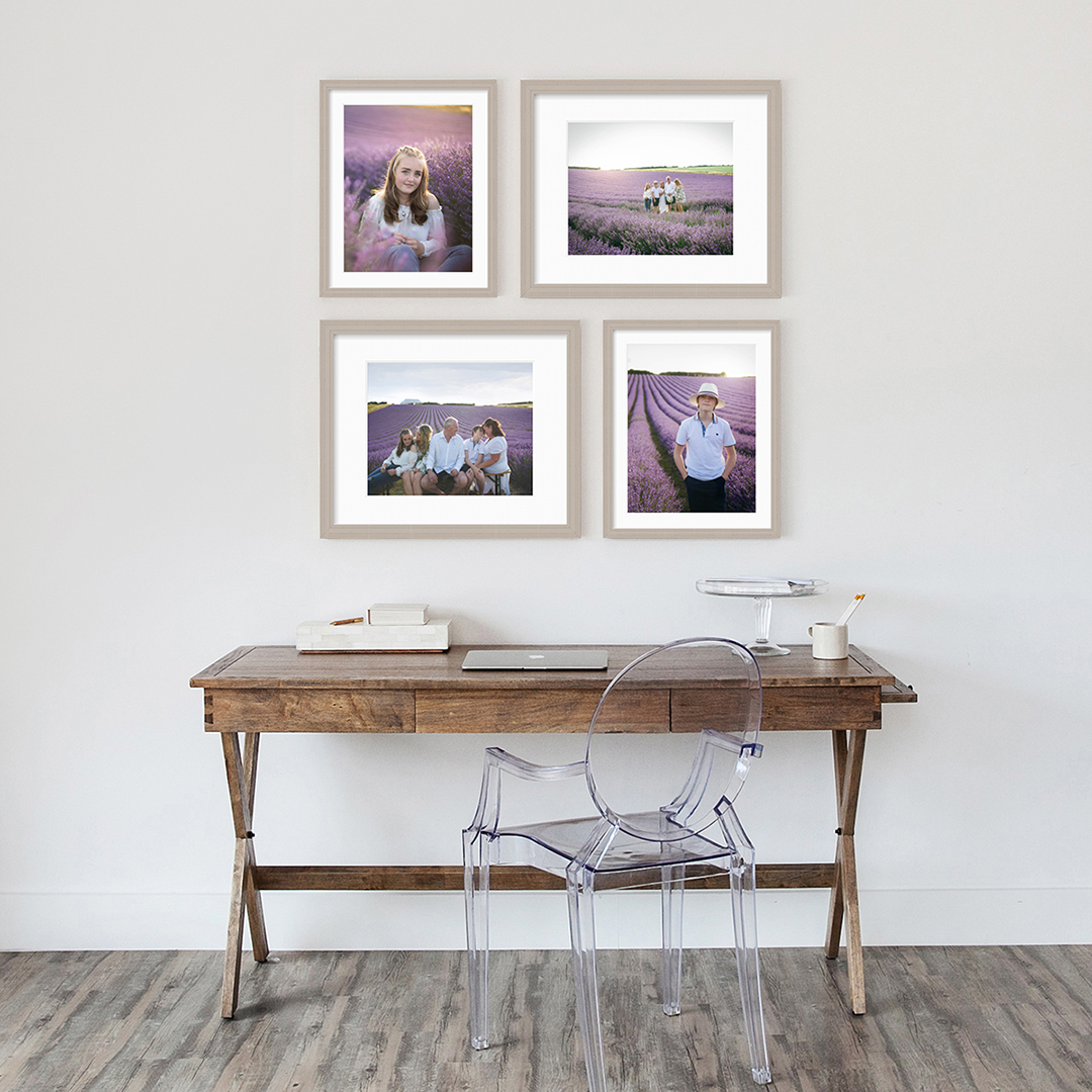 Wall display of four framed prints above wooden desk by Moira Lizzie Photography