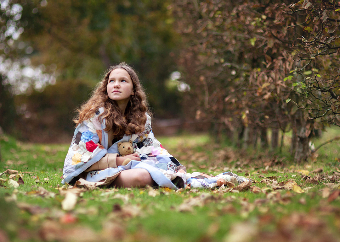 Girl with blanket on Autumn day