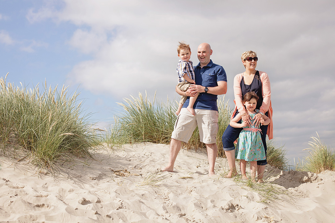 Family in sand dunes at East Head, West Wittering by Moira Lizzie Photography