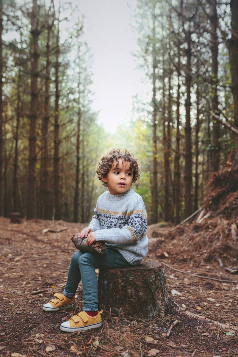 Hygge blog image of boy in woods with cosy jumper