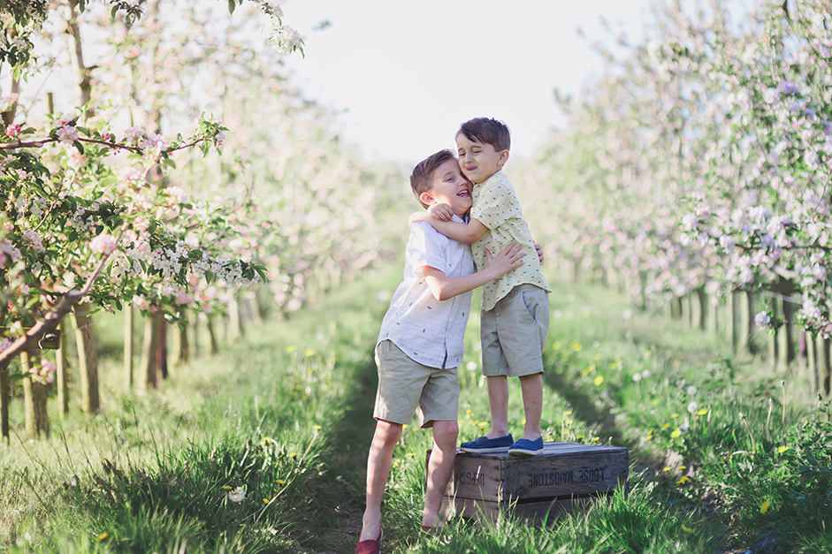 Brothers in apple orchard by Moira Lizzie Photography