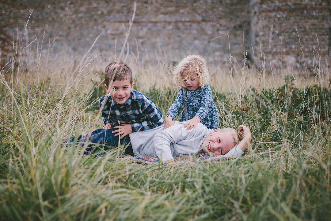 Three siblings outside Portchester Castle by Moira Lizzie Photography
