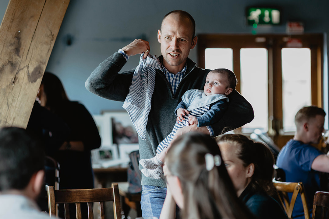 Documentary photograph of dad with baby