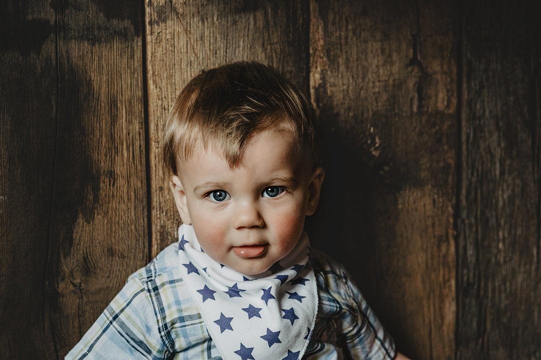 Portrait of baby boy with bib