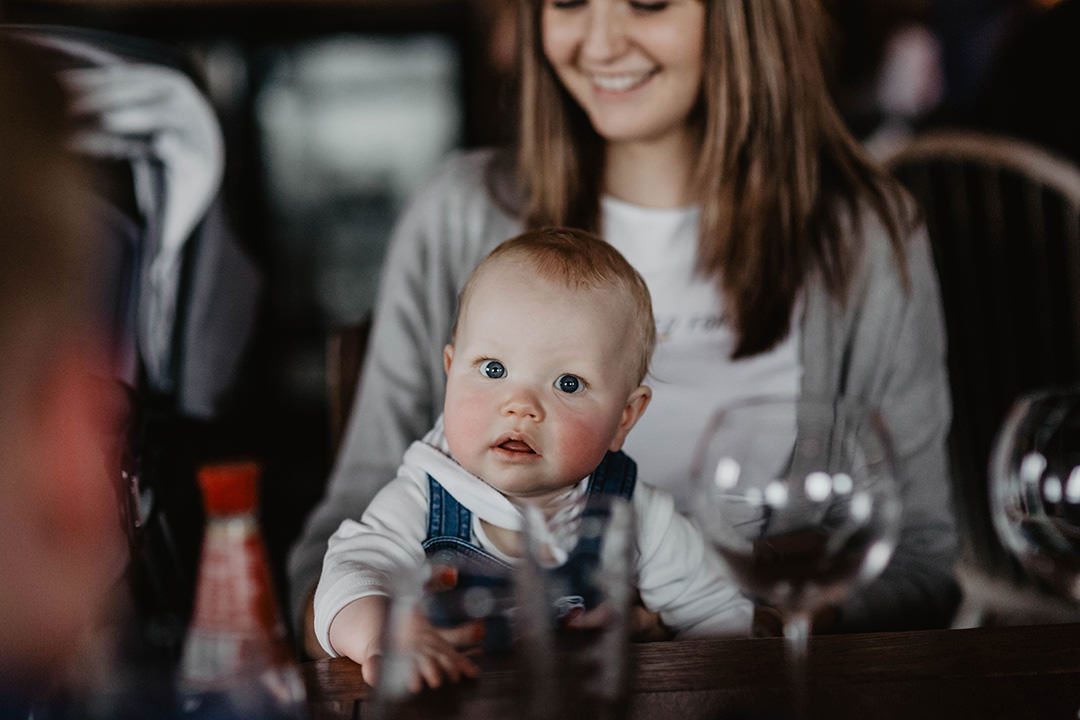 Documentary image of mother with baby at Lets Talk Birth and Baby antenatal class reunion