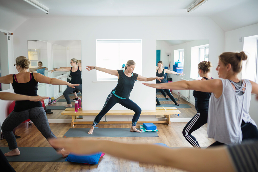 Prega-Mumma's Yoga class image with instructor and attendees