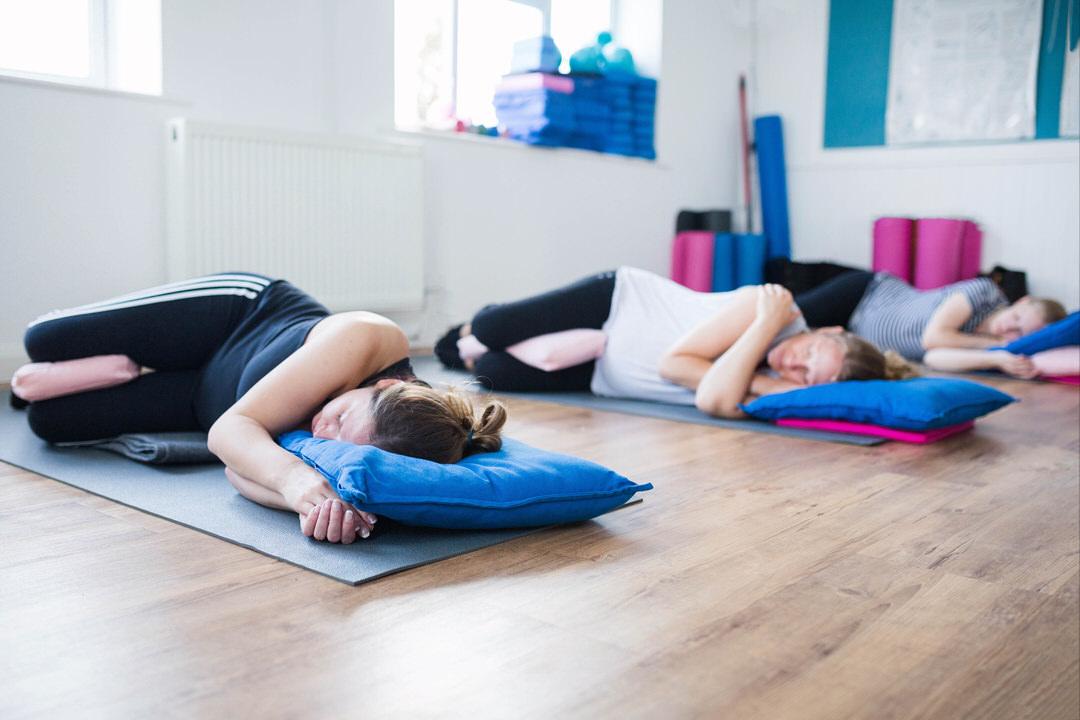 Image of Prega-Mumma's Yoga class attendees enjoying relaxation