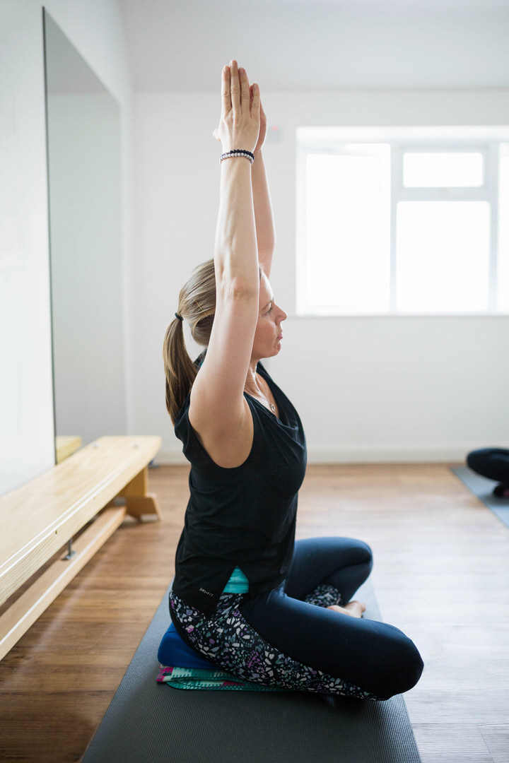 Yoga Class Instructor Stretching