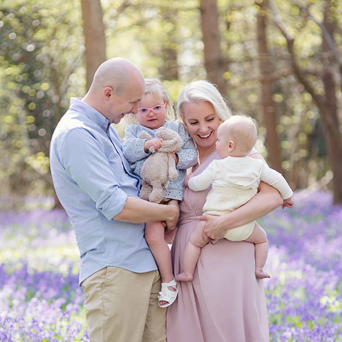 Young family at bluebells mini session in west sussex woodland by photographer moira lizzie photography