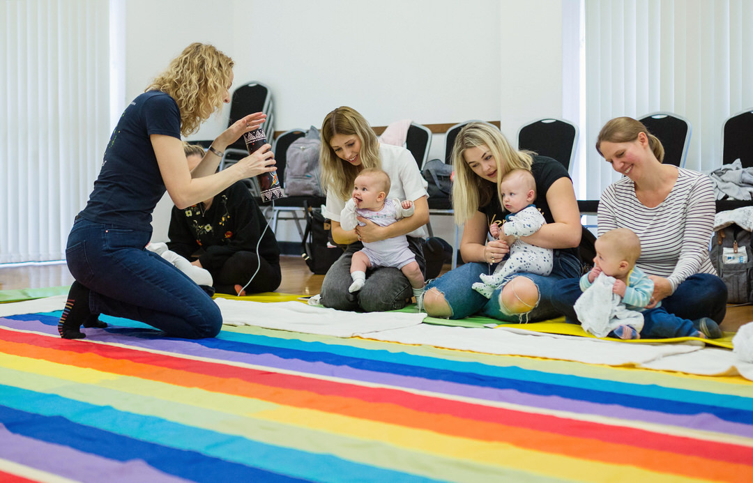 Image of Baby Sensory class being introduced to thunder maker