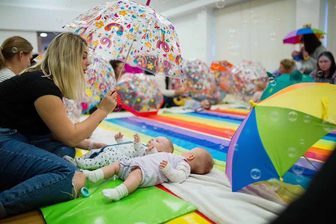 Image of bubbles and umbrellas at Baby Sensory class