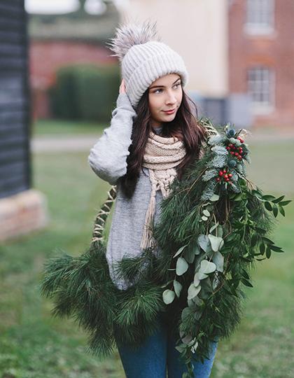 Nordic style image of girl with Christmas wreath
