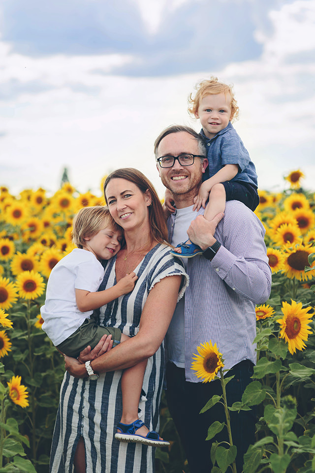 Family session in sunflower field featuring Pantone Illuminating by Moira Lizzie Photography